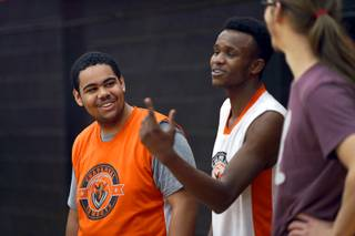 Chaparral High School basketball player Nick Doland, left, chats with teammates during practice at the school Wednesday, Jan. 03, 2018. Doland, a special needs student, scored his first career points during a tournament game last week.