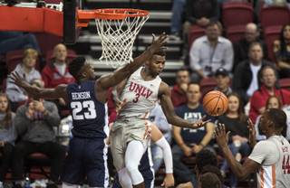 UNLV Rebels guard Amauri Hardy (3) dishes off a pass to teammate UNLV Rebels forward Brandon McCoy (44) with Utah State Aggies forward Daron Henson (23) defending close during their game at the Thomas & Mack Center on Saturday, Jan. 6, 2018.