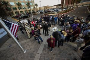 Supporters gather about as Cliven Bundy speaks during his press ...
