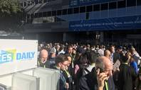 Some of the thousands of CES attendees wait outside the Las Vegas Convention Center or head to one of the gadget show's other sites after a power outage Wednesday, Jan. 9, 2018.