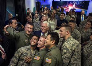 Vice President Mike Pence stands with members of the military for a photo while joining Secretary of the Air Force Heather Wilson and Senator Dean Heller to deliver remarks at the grand opening of AFWERX Vegas on Thursday, Jan. 11, 2018.