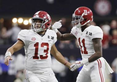Alabama quarterback Tua Tagovailoa congratulates Henry Ruggs III (11) after his touchdown catch during the second half of the NCAA college football playoff championship game against Georgia, Monday, Jan. 8, 2018, in Atlanta.