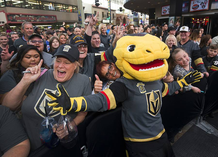 The Vegas Golden Knights mascot Chance the Golden Gila Monster poses with fans during a Vegas Golden Knights Fan Fest at the Fremont Street Experience in downtown Las Vegas Sunday, Jan. 14, 2018.