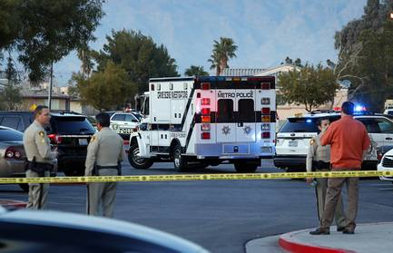 A Metro Police Crime Scene Investigations truck arrives at  a homicide scene at the Kensington Suites, 2200 W. Bonanza Road, near Rancho Drive Tuesday, Jan. 16, 2018.