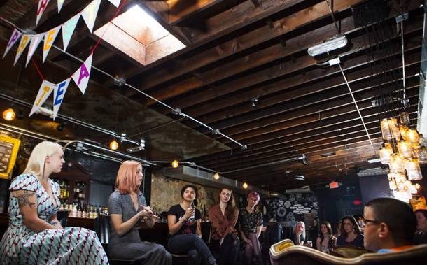Victoria Hogan, second from left, of Flora Pop, a pop-up wedding and floral design business, speaks during the High Priestess Tea gathering, a women's empowering social, at Velveteen Rabbit in Las Vegas on Saturday, Jan. 13, 2018.