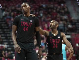 UNLV Rebels forward Brandon McCoy (44) is consoled by UNLV Rebels guard Jordan Johnson (24) after a bad foul and technical which turned the game around versus the New Mexico Lobos during their game at the Thomas & Mack Center on Wednesday, Jan. 17, 2018.