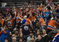 Edmonton Oilers fans celebrate their overtime win over the Vegas Golden Knights during their game at the T-Mobile Arena on Saturday, Jan. 13, 2018.