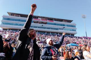 Attendees react to a speech by Melissa Harris Perry during the Women's March: Power to the Polls at Sam Boyd Stadium, Sunday, Jan. 21, 2018.