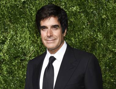 The tricks behind a disappearing act that magician David Copperfield performed for years in Las Vegas were revealed in court Friday, the first day of trial in a civil case brought by a British ...