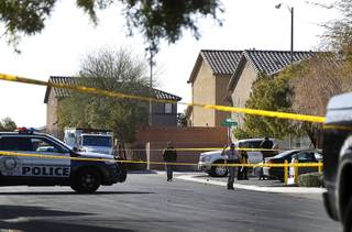 Metro Police and crime scene analysts investigate at the scene of an officer-involved shooting on Elcadore Street in a neighborhood near Las Vegas Boulevard and St. Rose Parkway Friday, Jan. 26, 2018.