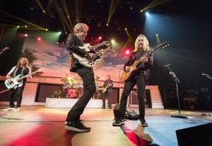 Don Felder, left, and Tommy Shaw team up for the double-guitar solo in the Eagles'