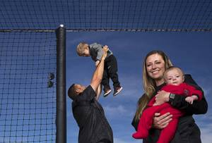 UNLV head softball coach Kristie Fox-Jarvis poses with her son Mikie, 4 months, her husband and assistant coach Andy Jarvis and