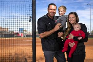UNLV head softball coach Kristie Fox-Jarvis poses with her son ...