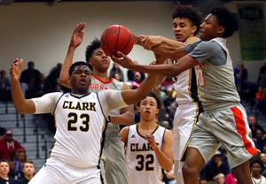 Clark High School and Bishop Gorman High School players fight for a rebound during a game at Clark High School Tuesday, Jan. 30, 2018. From left: Antwon Jackson (23), Isaiah Cottrell (0), Ian Alexander (32), Jalen Hill (21) and Zaon Collins (10).