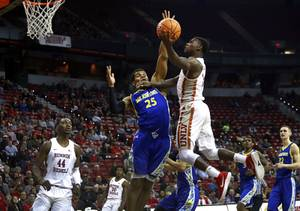 UNLV Rebels guard Amauri Hardy (3) takes a shot over ...