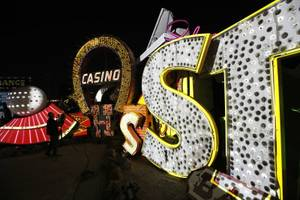 In this Jan. 24, 2018, photo a videographer shoots video of an exhibit at the Neon Museum in Las Vegas. Starting this week, visitors will be able to see many of the city's classic neon signs just like they were decades ago through a type of augmented reality that projects realistic animations onto the non-working signs.