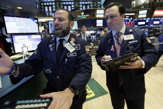 Dow closes up more than 560 points after another volatile day