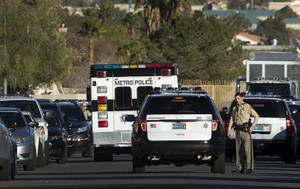 Las Vegas Metro Police are shown on Atwood Avenue near ...