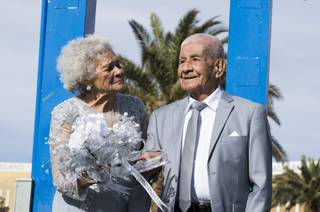 Onesino and Lucina Ramirez stand at the Welcome to Fabulous Las Vegas Sign on Friday, January 19, 2018. Onesino, 99, and Lucina, 91, will celebrate both their 75th anniversary and Onesinos 100th birthday this month.