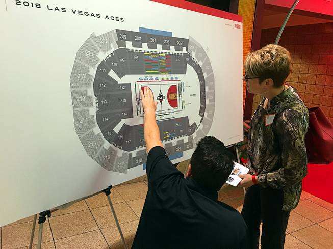 A Las Vegas Aces season ticket holder chooses seats for the WNBA franchise's inaugural season at the Mandalay Bay Event Center, Tuesday, Feb. 6, 2018.
