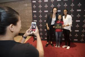 Lauren Mercado has her photo taken with Las Vegas Aces Kayla McBride, left, and Moriah Jefferson during the season ticket holder seat selection for the newest WNBA team the Las Vegas Aces Tuesday, February 6, 2018, at the Mandalay Bay Events Center.