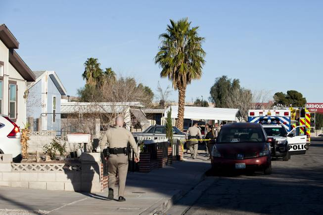 Crime scene investigators and Metro Police are on the scene of a construction death at a mobile home park near Nellis Boulevard and Desert Inn Road where a construction worker was killed after a section of a mobile fell on him, Thursday, February 8, 2018.