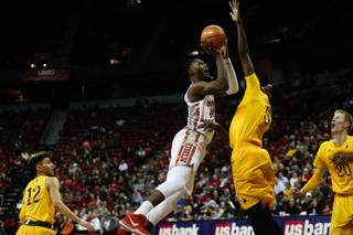 UNLV Rebel's Brandon McCoy (44) lays up the ball against Wyoming Cowboy's Alan Herndon (5) at the Thomas & Mack Center, Saturday, Feb 10, 2018. WADE VANDERVORT