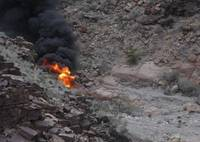 A preliminary report says a sightseeing helicopter spun at least twice before crashing in the Grand Canyon, killing three British tourists and injuring three others and the pilot.