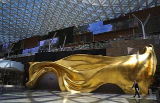 A man walks inside the MGM Cotai Resort in Macau Tuesday, Feb.13, 2018. MGM Resorts is opening a lavish multibillion-dollar casino resort in Macau, in the latest big bet by foreign gambling companies on the southern Chinese gambling haven.  (AP Photo/Vincent Yu)