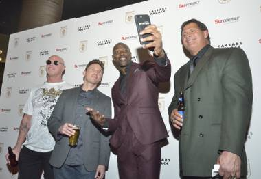 Six-time Pro Bowler Terrell Owens is shown taking a selfie with, from left, two-time Super Bowl winning quarterback Jim McMahon, host Martin Montana, and Two-time World Series champion Jose Canseco during a red carpet event at Alto Bar for the opening of Renegades, a new interactive show featuring sports celebrities at Cleopatra's Barge in Caesars Palace at 3570 S. Las Vegas Blvd. in Las Vegas on Friday, Feb. 9, 2018. The show is slated to give fans a chance to hear stories and ask questions from sports stars.