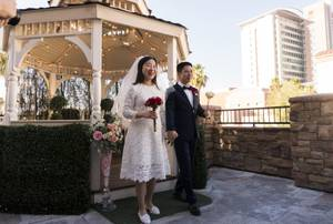 Randy Wang, right, and Ha Na, left, both from Beijing China, get married on Valentine's Day at Vegas Weddings on, Wednesday, February 14, 2018.