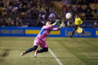 Lights goalkeeper stops the ball during the Lights spring training match against the Vancouver Whitecaps Saturday, February 17, 2018 at Cashman Field.