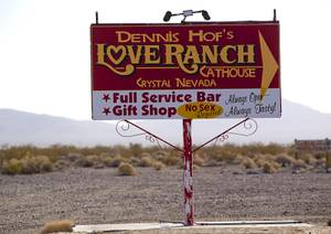 A sign gives direction to Dennis Hof's Love Ranch brothel in Crystal, Dec. 20, 2017.