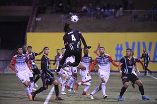 Players watch as Las Vegas Lights Joel Huiqui heads the ball towards the goal during their final preseason game against D.C. United Saturday, February 24, 2018, at Cashman Field. D.C. United won the game 4-2. CREDIT: Sam Morris/Las Vegas News Bureau
