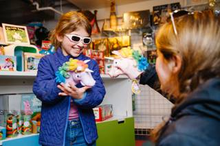 Esme Berger, 8, plays with unicorn puppets with her mother Miranda Berger at Kappa Toys located in Container Park, Downtown, Tuesday, Feb. 20, 2018.