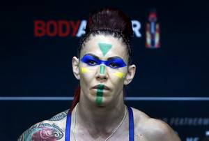 Cris Cyborg of Brazil poses on the scale during UFC ...