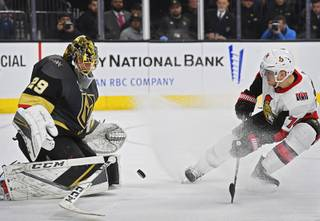 Even after dropping his stick, Vegas Golden Knights goaltender Marc-Andre Fleury (29) stops a point blank shot by Ottawa Senators defenseman Mark Borowiecki (74) during their NHL hockey game Friday, March 2, 2018, at T-Mobile Arena in Las Vegas. Ottawa won the game 5-4.