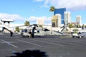 Helicopters depart the Las Vegas Convention Center after the end ...