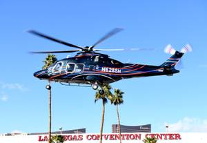 Helicopters depart the Las Vegas Convention Center after the end of the 2018 HAI HELI EXPO by Helicopter Association International . Friday, March 2, 2018.