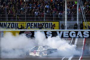 Driver Kevin Harvick (4) celebrates with a burnout after winning ...