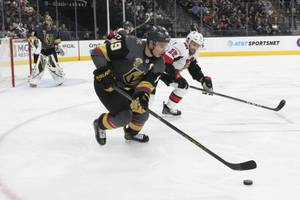 Vegas Golden Knights right wing Reilly Smith (19) is chased by Ottawa Senators left wing Zack Smith (15) during their NHL hockey game Friday, March 2, 2018, at T-Mobile Arena in Las Vegas. Ottawa won the game 5-4.