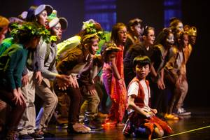 Students from Dr. C. Owen Roundy Elementary performs a scene ...