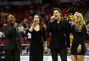 "The ""Cocktail Cabaret"" performs the national anthem before a game ..."