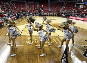 UNR cheerleaders perform before a game against UNLV in the ...