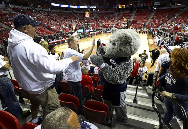 UNR mascot Alphie greets fans during a game against UNR in the 2018 Mountain West Men's Basketball Championship at the Thomas & Mack Center Thursday, March 8, 2018.