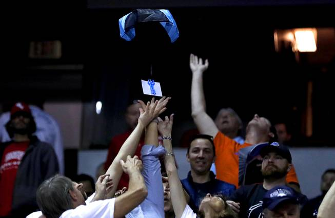 A certificate for a Port of Subs sandwich floats down to fans during a game against UNR in the 2018 Mountain West Men's Basketball Championship at the Thomas & Mack Center Thursday, March 8, 2018.