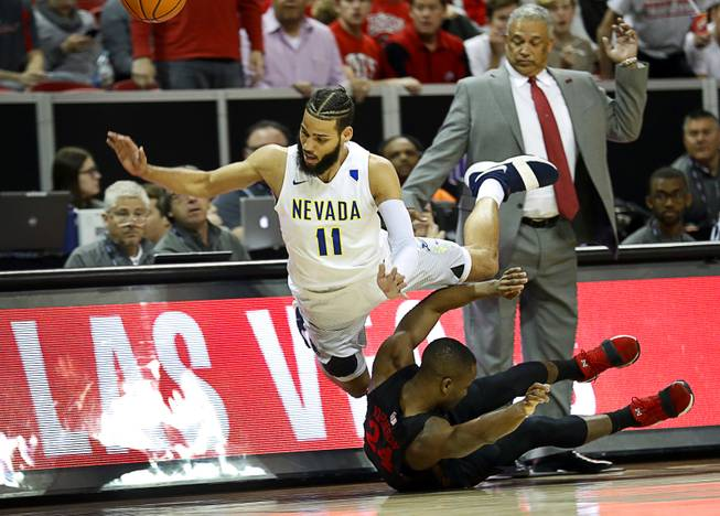 Nevada Wolf Pack forward Cody Martin (11) and UNLV Rebels guard Jordan Johnson (24) go out of bounds while chasing a loose ball during a 2018 Mountain West Men's Basketball Championship game at the Thomas & Mack Center Thursday, March 8, 2018.