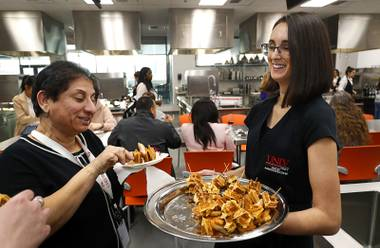 Zoe Sephos serves chicken and waffle skewers to guests during a food sampling day at UNLV's Hospitality Hall Wednesday, March 7, 2018. The sampling is part of the preparation for UNLVino, a wine, food, and spirits festival, scheduled for Saturday, April 14.