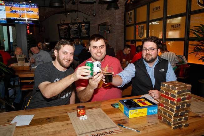 From left, Tyler Borland, Chris Shumaker and Joseph Nixon of Columbus, Ohio, pose for a photo during the first rounds of March Madness at Beerhaus, Thursday, March 15, 2018.