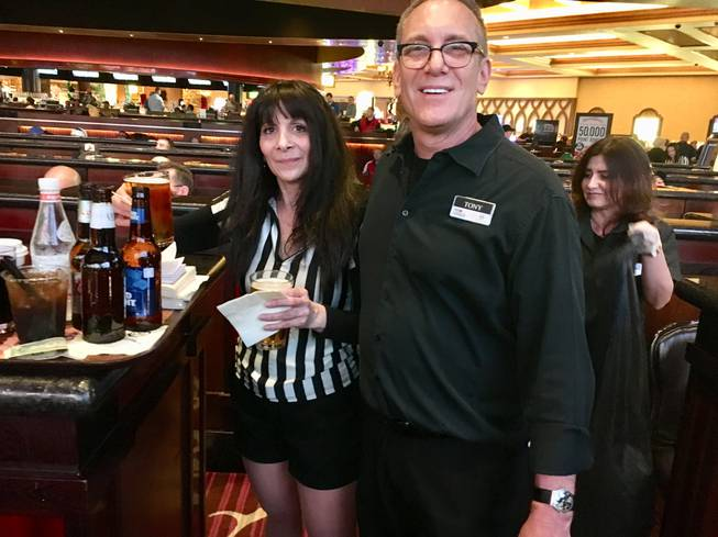 Green Valley Resort bartender Tony Deppe and server Nicole Ervolino work the sports book during the NCAA Tournament on March 15, 2018.